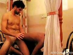 African cutie warms her white friend up with hot blowjob.